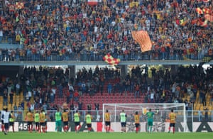 Lecce players celebrate in front of fans after the match.
