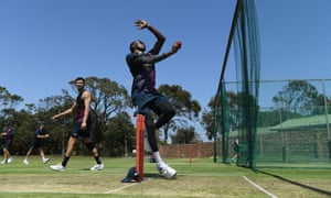Jofra Archer bowls in the nets as Mark Wood looks on at St George's Park in Port Elizabeth