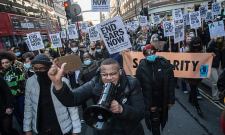 British Nigerians and fellow supporters march through central London to demand the disbanding of the Sars unit in October.