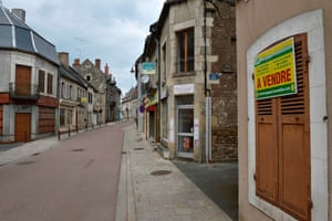 'For sale' signs in the empty streets of Varzy, France.