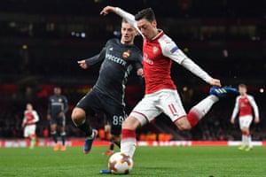 Arsenal's Mesut Ozil fires in a cross.