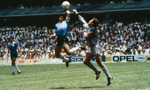 Diego Maradona tickles the ball over the head of England's Peter Shilton to give Argentina a 1-0 lead at the Azteca Stadium.