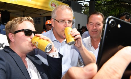 Scott Morrison (centre) has a selfie taken with racegoers on Melbourne Cup day at the Corbould Park racecourse on the Sunshine Coast.