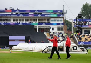 The umpires inspect the pitch.