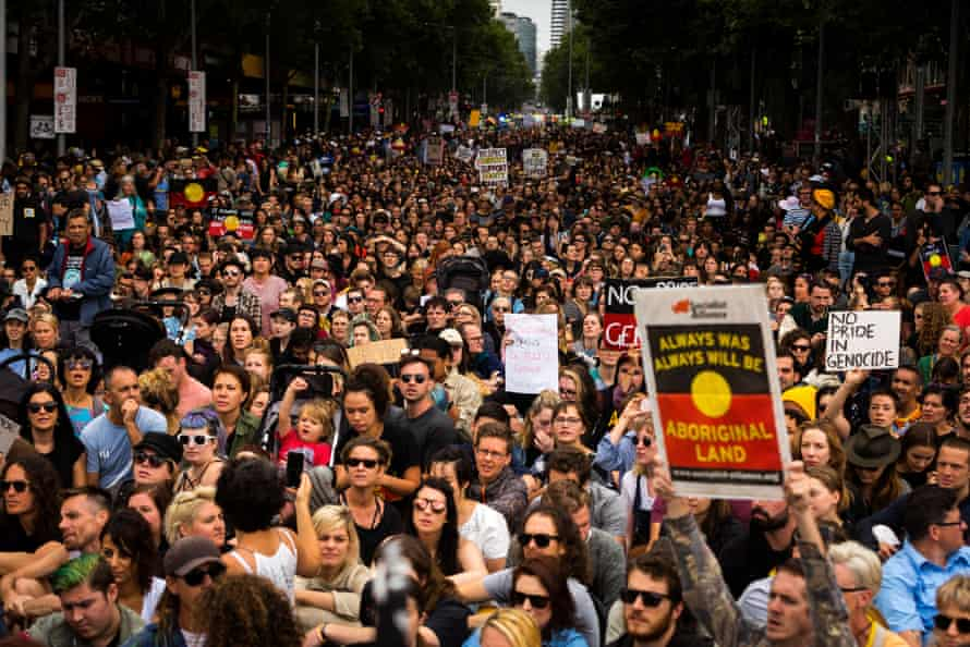 Thousands march through Melbourne on 26 January 2017 to raise awareness of Indigenous rights and protest the celebration of Australia Day/Invasion Day.