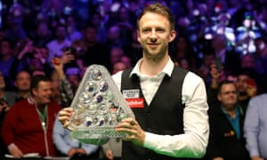 Judd Trump poses with the Masters trophy after beating Ronnie O'Sullivan 10-4.