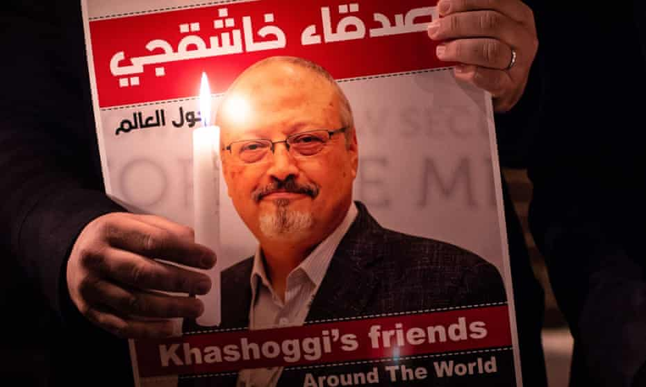 A demonstrator holding a poster of Jamal Khashoggi outside the Saudi consulate in Istanbul