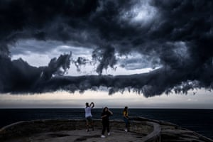 People watch from Marks Park as a thunderstorm gathers off Bondi Beach in Sydney.