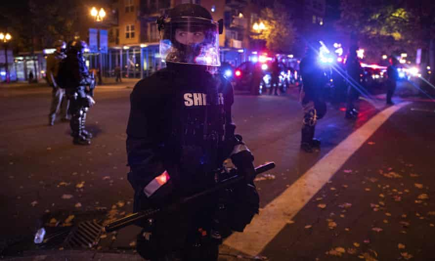 Vancouver police stand guard downtown.