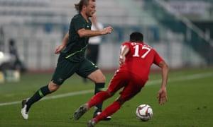Rhyan Grant of Australia competes for the ball with Ali Al Busaidi of Oman at Maktoum Bin Rashid Al Maktoum stadium in Dubai.