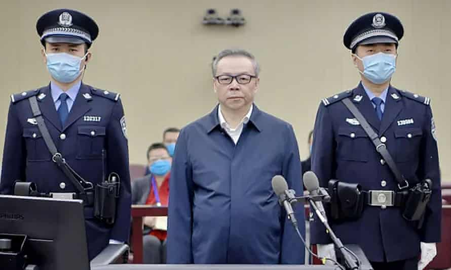 Lai Xiaomin in the dock with two officers