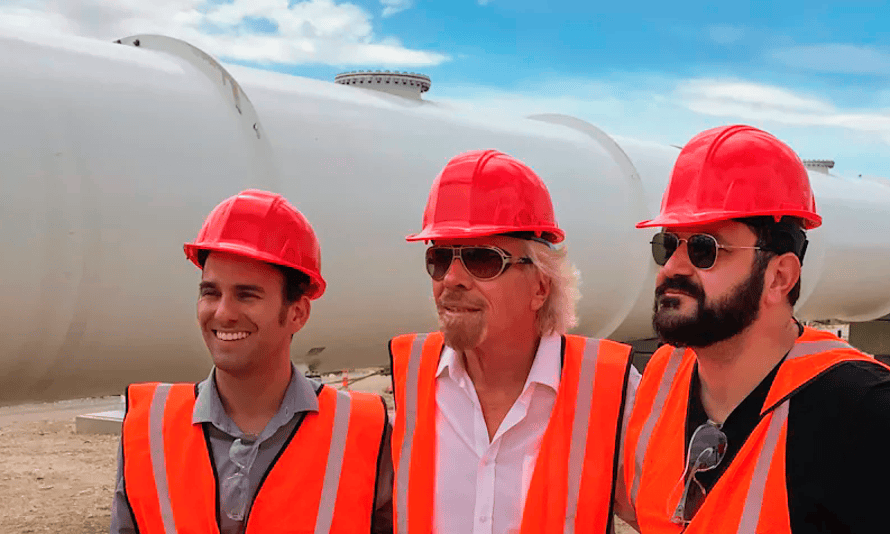 Sir Richard Branson (centre) pictured in front of the Hyperloop One technology.