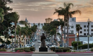 Statue overlooking Downtown Ventura at sunset