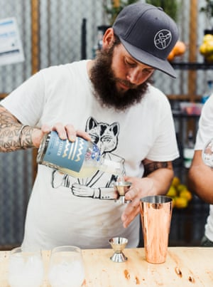 A bartender making a cocktail using Dasher and Fisher Distillery gin.