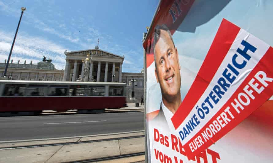 A tram passes an election poster for Norbert Hofer's Freedom party in Vienna