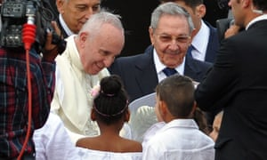 Pope Francis is welcomed by Cuban president Raúl Castro and Cuban children upon landing at Havana's international airport.