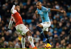 Fernandinho, right, was deployed at centre-back against Arsenal.