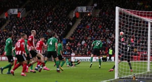 Sheffield United's Enda Stevens scores from a tight angle.