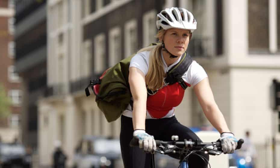 young woman commuting by bike