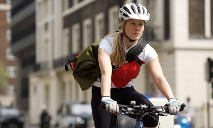 Young Woman Riding Bicycle to Work