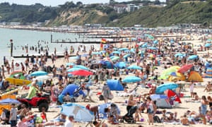 People enjoying the heatwave on Bournemouth beach in Dorset as the hot weather spread across the UK in summer, marking the driest start to a summer since modern records began in 1961.