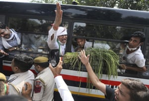 New Delhi, India  Members of India's opposition Congress party shout as they are detained during a protest against agriculture bills