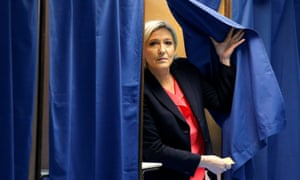 Marine Le Pen emerges from a pooling booth.