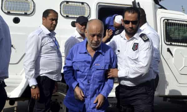 Al-Baghdadi Ali al-Mahmoudi, former prime minister of Libya, arrives for a hearing at a courtroom in Tripoli in September 2013.