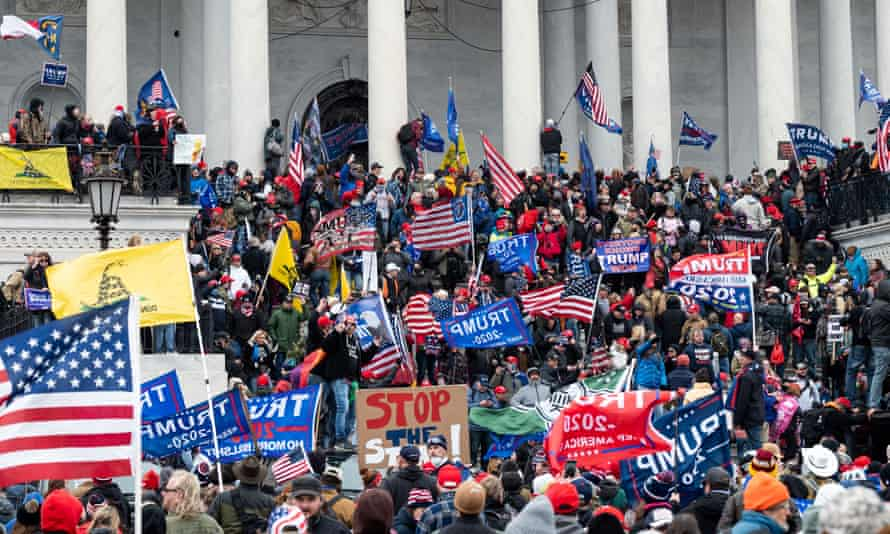 Protesters gather at the steps of the US Capitol during the pro-Trump rally in Washington on 6 January