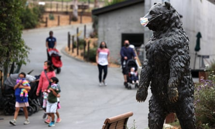 A masked bear statue greets visitors to the Oakland Zoo in Oakland, California.