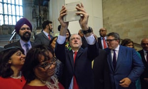 Jeremy Corbyn takes a selfie with Labour MPs in Westminster Hall.