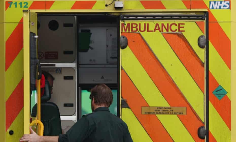 Paramedic opens ambulance door