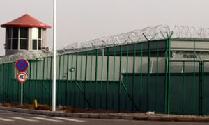 A guard tower and barbed wire fences are seen around the Artux City Vocational Skills Education Training Service Center in Artux in western China's Xinjiang region, in 2018.