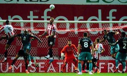 Brentford's Pontus Jansson jumps for the ball against Swansea.