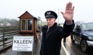 A protester dressed as a customs official at a mock checkpoint on the Northern Ireland border, 2017