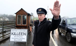 Anti-Brexit demonstrators dress as custom officials at a mock customs checkpoint at the Northern Irish border.