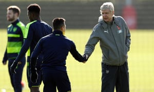 Arsène Wenger shakes hands with Arsenal's Alexis Sánchez as Arsenal prepare for their Champions League tie against Bayern Munich.