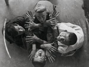 Four Bauhaus students in a circle: Robert Lenz (top), Hin Bredendieck (right), Lony Neumann (bottom) and Hermann (Sven) Gautel