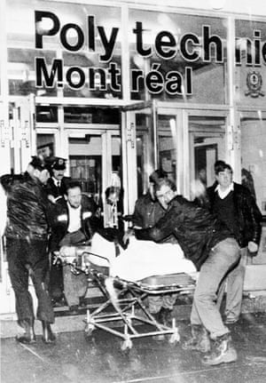 A victim is wheeled away from the scene after a gunman opened fire in a packed classroom on 6 December 1989.