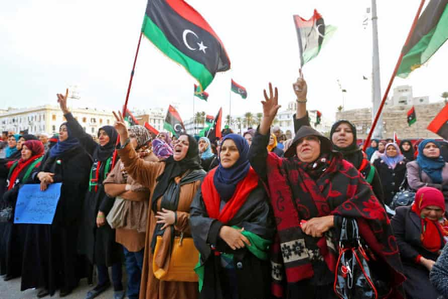 """Libyan protesters at a rally in Tripoli's Martyr's Square in support of """"Fajr Libya"""" (Libya Dawn). Delegates from Libya's rival parliaments recently held indirect talks aimed at ending months of of violence."""