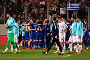 Greece players look on as Croatia seal their place at the World Cup.