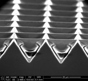 Weird and Wonderful category 2ndHighland cattle solar cells (Ancient power) by Dr Lourdes Ferre Llin, University of Glasgow: This image shows a side view of a group of solar cells, and was taken after dopant was driven into the cells to form an internal electrical field. The sample was damaged while it was being prepared for inspection, uncovering a cross-section of inverted pyramids with little horns at the top, mimicking the heads of highland cattle.
