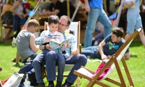 A parent reading to his son at the Hay literature festival in 2015.