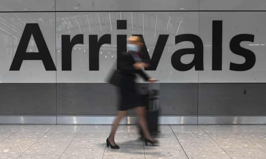 A passenger arrives at Heathrow airport in London