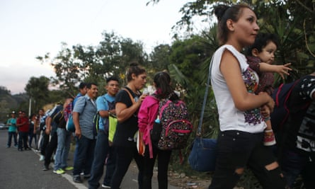 Honduran migrants, part of a new 'migrant caravan', wait in line to cross over the border checkpoint into Guatemala on 15 January 2019 in Agua Caliente, Honduras.