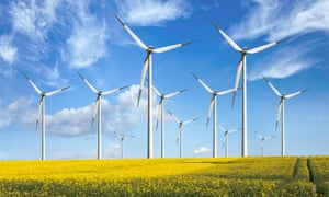 Wind turbines in a field of rapeseed