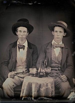 Unknown photographer. Portrait of two unidentified young men drinking liquor c.1850. Daguerreotype