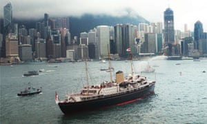 the royal yacht Britannia sails into Hong Kong harbour on 23 June 1997.