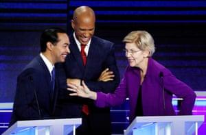 Julián Castro, Cory Booker and Elizabeth Warren talk during a break at the first Democratic debate.