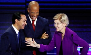 Elizabeth Warren speaks with Julián Castro and Cory Booker at the first Democratic debate in Miami, Florida, on 26 June.
